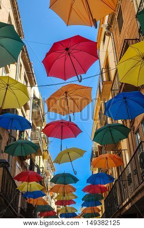 Antique Street Decorated With Colored Umbrellas.