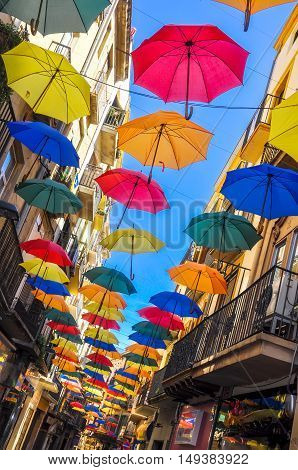 Antique Street Decorated With Colorful Umbrellas.