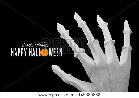 Origami skeleton bone halloween hand on white background