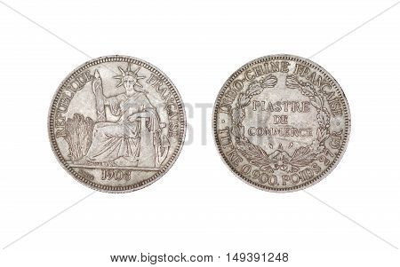 A French Indo-China Silver 1 Piastre Trade Dollar 1908 isolated on white / French Indochinese piastre