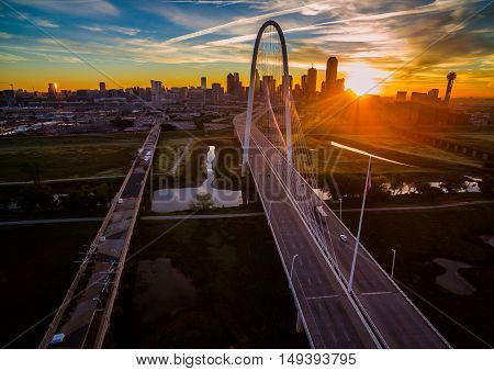 Sunrise Above Dallas Texas Aerial Shot Over Margaret Hunt Hill Bridge Downtown Skyline Cityscape with solar flare