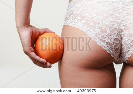 Girl Holding Orange Next To Bottom