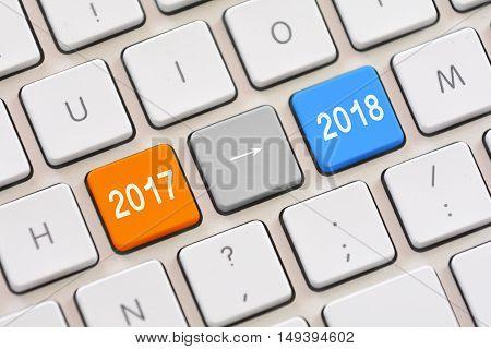 Year 2017 to year 2018 on white keyboard