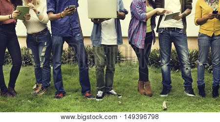 College Students Using Digital Devices Concept