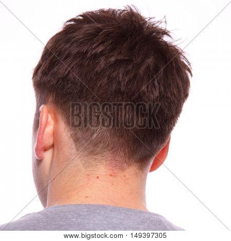 Twenty something brown haired man headshot from behind