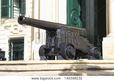 Cannon before Auberge de Castille in capital of Malta - Valletta Europe.
