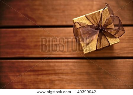 Golden Gift Box On Table Wooden Slats Top View