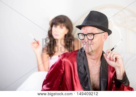 Playboy And Woman In Bed Smoking