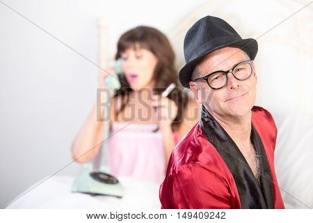 Playboy With Woman On The Phone And Smoking In Background