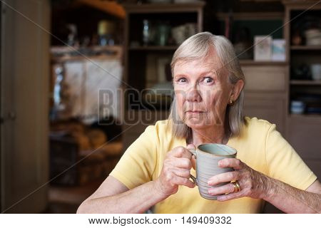 Angry Mature Woman Holding Cup