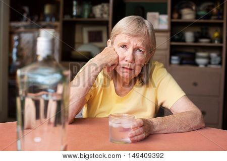 Woman With Hand On Cheek While Drinking Booze