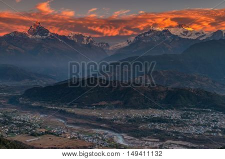 Beautifull cloudy sunrise in the mountains with snow ridge fron Himalaya view point Pokhara Nepal