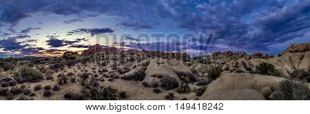 Desert scene turing into night during sunset also called golden hour