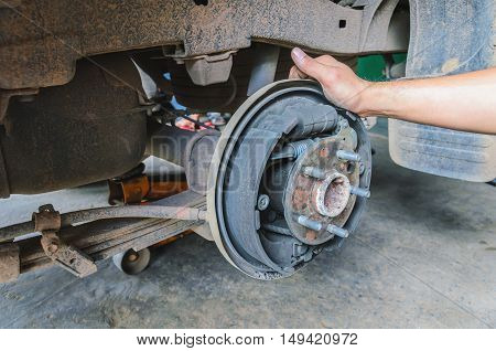 mechanic changing maintenance Disc brake on car