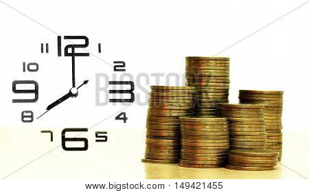 Coins Stack And Alarm Clock On White Background Business Concept
