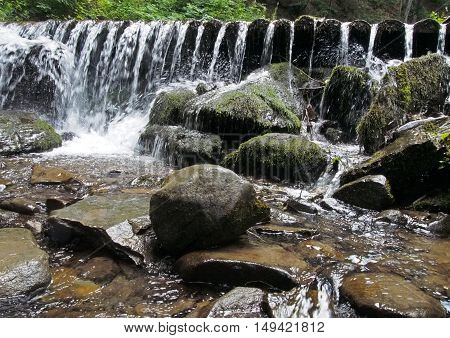 Mountain river with thresholds and falls in the Ukrainian Carpathians
