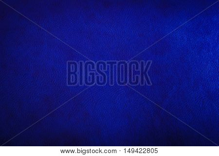 Navy glossy leather texture abstract iridescent material dark blue toned rough surface background in horizontal orientation nobody.