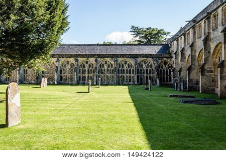 Wells UK - August 15 2015: Churchyard and cloister in the Cathedral of Wells. Wells is a Cathedral City in Somerset.