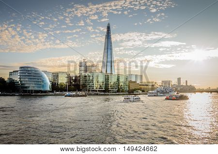 LONDON UK - AUGUST 21 2015: London City Hall and waterfront at sunset. The City Hall was designed by Norman Foster.