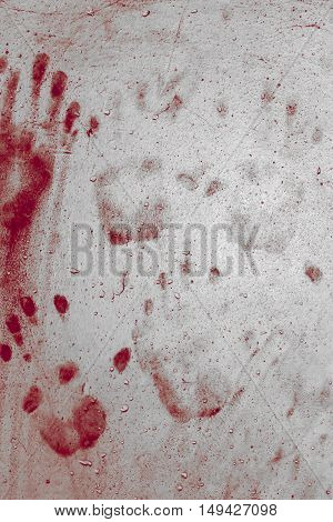 Grunge background with a print of a bloody hands. Ideas for background Halloween.
