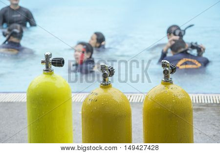 yellow air cylinders blur background for scuba