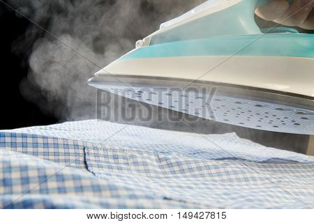Iron Blowing Off Steam Over Shirt