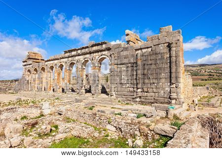 Volubilis near Meknes in Morocco. Volubilis is a ruined Amazigh then Roman city in Morocco near Meknes UNESCO World Heritage Site. poster