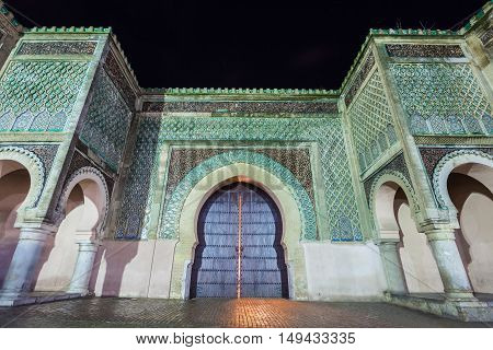 The Bab Mansour in Meknes Morocco at night. Gate Bab Mansour Gate named after the architect El-Mansour. Gate Bab Mansour is a main gate in Meknes Morocco. poster