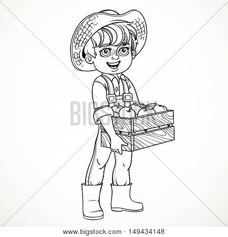 Cute boy farmer in jeans overalls and rubber boots holding a wooden box with apple line drawing for coloring isolated on white background
