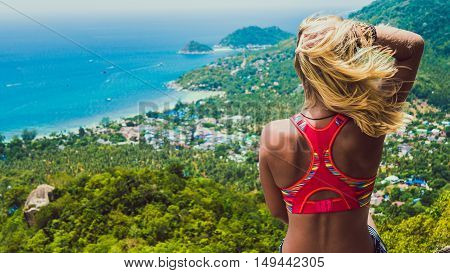 Young Beuatiful Girl is Sitting on Koh Tao Island View to Sairee Beach and Nang Yuan Island