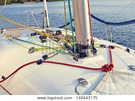 Preparation of staysail for use. Tie the sheets to genoa on the boat