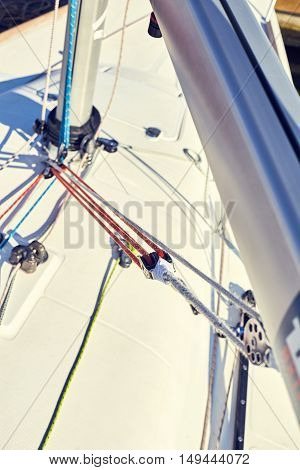A boom vang or kicking strap is a line or piston system on a sailboat used to exert downward force on the boom and thus control the shape of the sail.