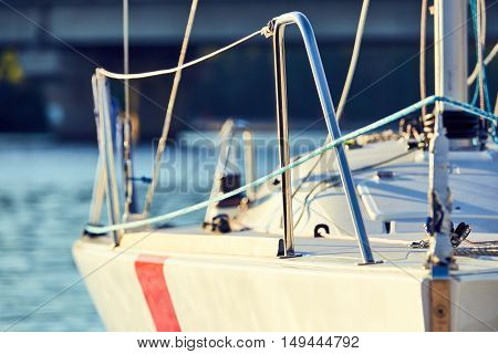 Equip yacht with, weather and lee braces for spinnaker