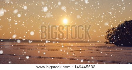 beautifu sunset on the frozen lake in winter snowfall time