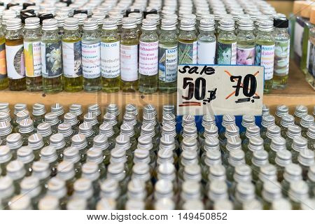 Essential Oils In Small Glass Bottles On A Market