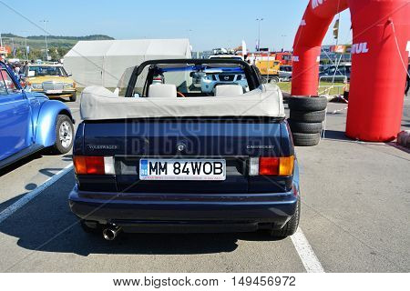 CLUJ-NAPOCA ROMANIA - SEPTEMBER 24 2016: Volkswagen golf cabrio 1800 classic convertible car in the parking lot