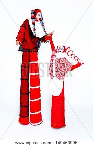 Two cheerful clown dressed in red and white cloth on a white background