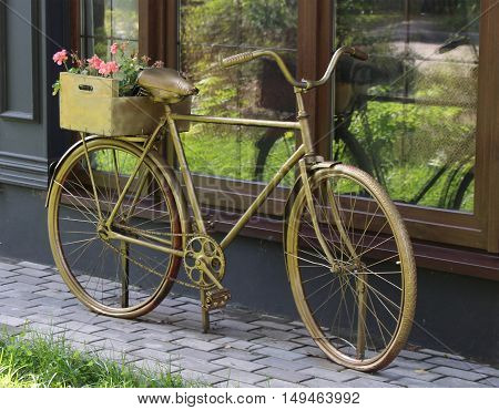 old rarity bronze retro bike & flowerbed