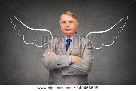 business, angel investor, safety, security and people concept - senior businessman with wings drawing over gray concrete background