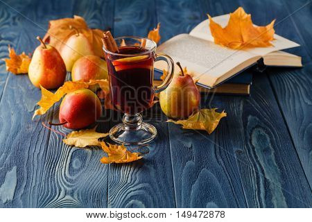 Mulled Wine With Spices And Autumn Decor On Wooden Table