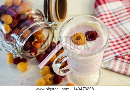 milkshake with berries fresh raspberries on a white background