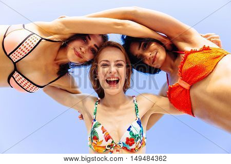Vacation. Beach Party. Teenage girls having fun in water. Group of happy young people dancing at the on beautiful summer sunset. Silhouettes teen jumping. Joyful friends