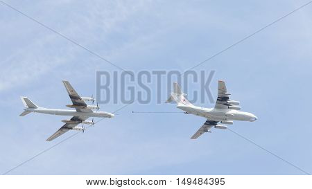 Moscow - May 9 2015: Il-78 and Tu-95 refuel in the air flying in the sky over Red Square on May 9 2015 Moscow Russia