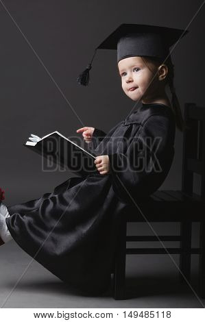 photo of diploma graduating little student kid