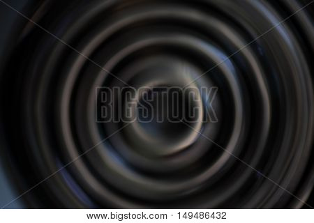 Black abstract background with defocused concentric circles