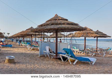 SHARM EL SHEIK, EGYPT - AUGUST 25, 2015: Tourists enjoy the sun, beach, and clear blue sea