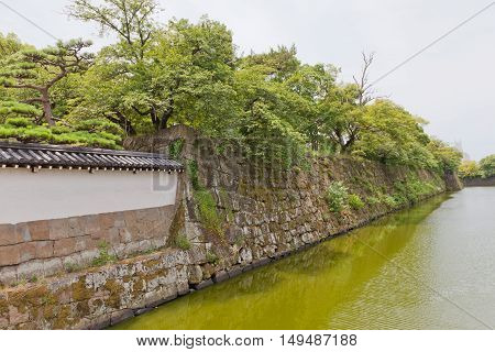 Moat (hori) and stone walls (ishigaki) of Wakayama castle Japan. Castle was erected in 1585 bombed out in 1945 reconstructed in 1958