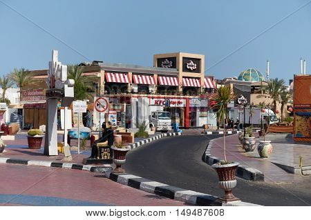 SHARM EL SHEIK, EGYPT - AUGUST 29, 2015: Small shopping mall shines in vivid colors against the sky