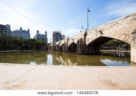 sea bridge in the Park Turia Gardens, reflection in the water, Valencia