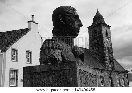 A view of a statue and the townhouse tower in Culross